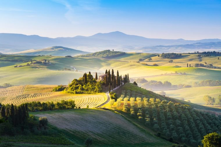 San Quirico d'Orcia, Siena province, Tuscany, Italy. May, 20, 2017. Farmhouse among tuscan hills during harvest period.